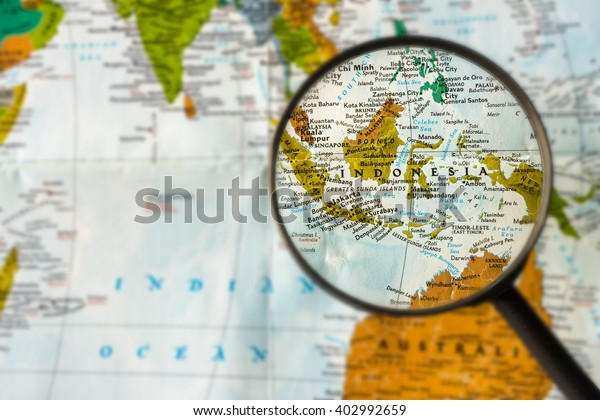 Map Indonesia Through Magnifying Gl Stock Photo (Edit Now ... on pakistan on world map, a turkey on world map, burma on world map, madagascar on world map, republic of congo on world map, thailand map, fiji on world map, strait of malacca map, bering sea on world map, new zealand on a world map, russia on world map, chile on world map, england on a world map, jakarta world map, belarus on world map, taiwan on world map, the sudan on world map, israel on world map, east indies on world map, philippines on world map,