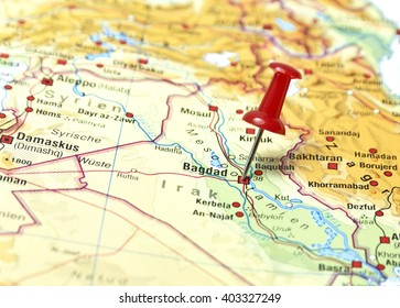 map of irak with pin set on bagdad