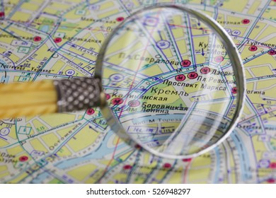 Map of Kremlin and magnifier glass.
