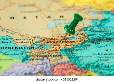 Map of Kyrgyzstan with a green pushpin stuck