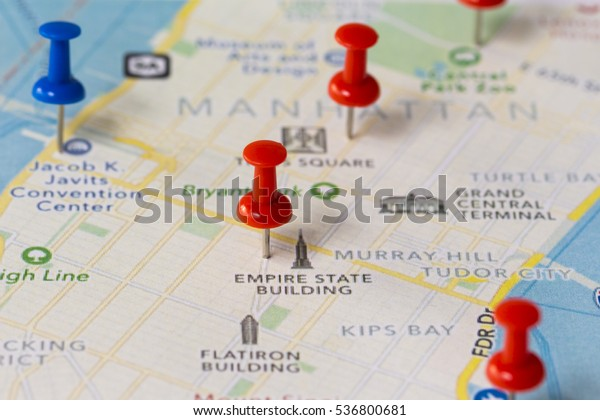 Map of Manhattan with push pins. Travel concept