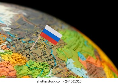 Map with miniature Flag of Russia. Selective focus on Russian Flag in Moscow