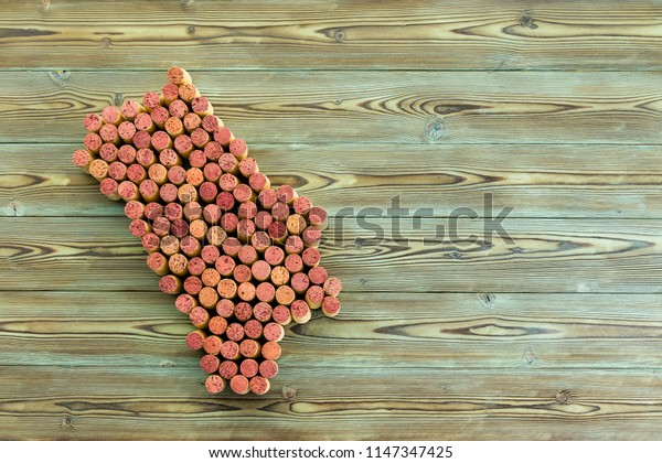 Map of the Napa Valley wine region formed of old stained red and white wine bottle corks over a rustic wood background with copy space