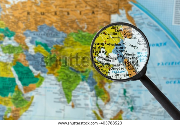 Map of North Korea through magnifying glass