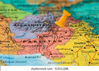 Map of Pakistan with a orange pushpin stuck