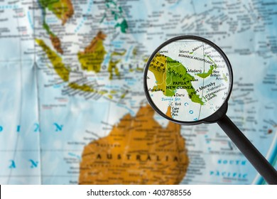 Map of Papua New Guinea through magnifying glass