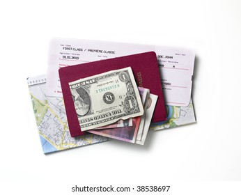 A map, a passport, a flight ticket, differnt currencys on a white surface.