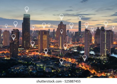 Map pin flat above blue tone city scape and network connection concept in bluetone