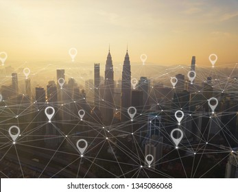 Map pin flat of city, global business and network connection in futuristic technology concept in Asia. Skyscraper and high-rise buildings at sunset in Kuala Lumpur Downtown, Malaysia.