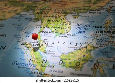 Map pin on Kuala Lumpur city with focused light