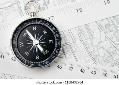Map of property or real estate location, direction, navigation and distance concept, compass with measuring tape on transportation and building map with street and road.