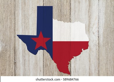Map of Texas with the Texas Flag colors on weathered wood background
