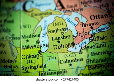 Map view of Michigan on a geographical globe. (vignette)