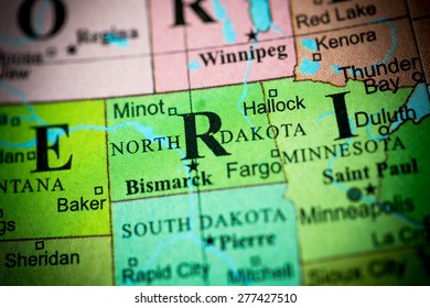 Map view of North Dakota on a geographical globe. (vignette)