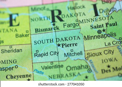 Map view of South Dakota on a geographical globe.
