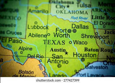 Map view of Texas on a geographical globe. (vignette)