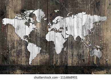 Map of the world cut out or carved in a board against the background of the board.