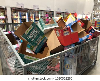 Maple Grove, Minnesota - Feb 22, 2019: Empty boxes sitting in a bin in the middle of an aisle, cluttering up the shopping area at a Costco Warehouse store.