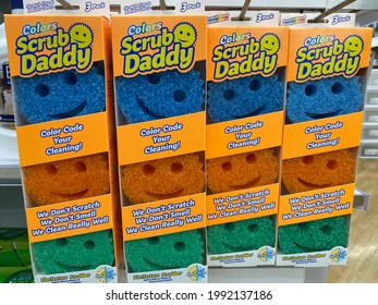 Maple Grove, Minnesota - June 16, 2021: Scrub Daddy sponges for sale at a store, packs of three