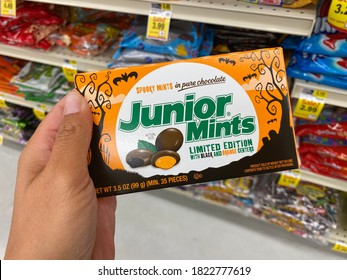 Maple Grove, Minnesota - September 14, 2020: Hand holds up a box of Limited Edition Halloween Junior Mints candy at a grocery store