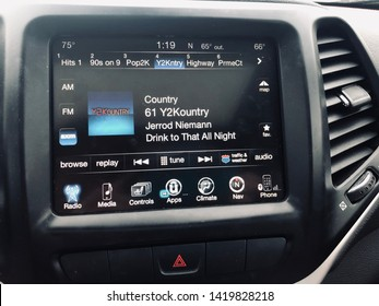 Maple Grove, MN - June 9, 2019: Car console display of the Sirius XM Satellite Radio in a Jeep SUV. Screen shows the Y2Kountry music station, with a Jerrod Niemann song playing