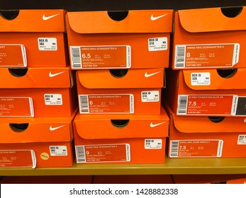 Maple Grove, MN - June 9, 2019: Boxes of orange Nike Athletic tennis and gym shoes for sale at a shoe store