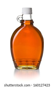 maple syrup in glass bottle on white background