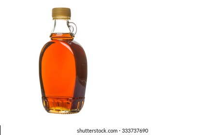 Maple syrup in a glass bottle over white background