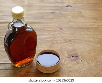Maple syrup in a glass bottle - sweet dessert sauce