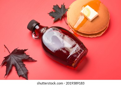 Maple syrup on a red background. Maple Syrup Pancakes