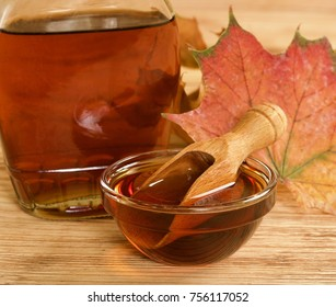 maple syrup on wooden background