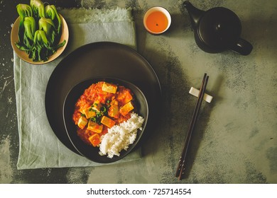 Mapo doufu or Mapo tofu is a popular Chinese dish from Sichuan province. It consists of tofu set in a spicy sauce, typically a thin, oily, and bright red suspension