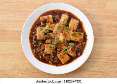 Mapo Tofu hot and spicy, Chinese food on white  plate and wood table.