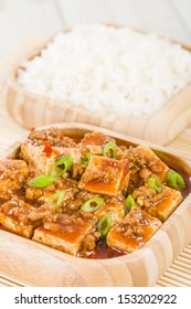 Mapo Tofu - Tofu and minced pork cooked with chili bean paste, fermented black beans, chili oil and Szechuan peppers, garnished with spring onions. Served with white steamed rice.