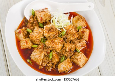 Mapo Tofu - Tofu and minced pork cooked with chili bean paste, fermented black beans, chili oil and Szechuan peppers, garnished with spring onions.