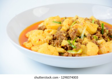 Mapo Tofu, popular Chinese dish.  The classic recipe consists of silken tofu, ground pork or beef and Sichuan peppercorn to name a few main ingredients.