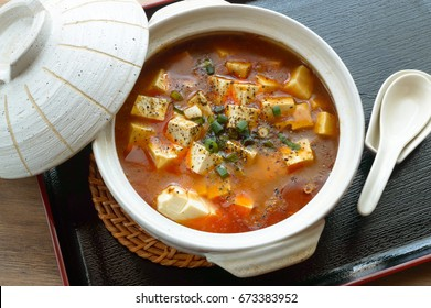 Mapo tofu is a popular Chinese dish from Sichuan province. It consists of tofu set in a spicy sauce, typically a thin, oily, and bright red suspension, along with minced  pork or beef.