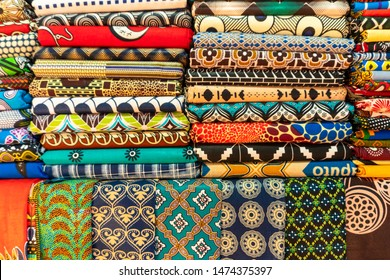 Maputo, Mozambique - August 8, 2019: Plenty of colorful african fabrics on local open air market, Maputo, Mozambique
