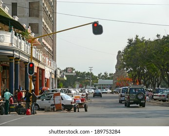 Maputo, Mozambique - December 11, 2008: in the capital of Mozambique. City life. Architectural structure. Unknown city residents go about their business. The road with cars.
