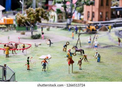 Maquette of circus artists show on the grass