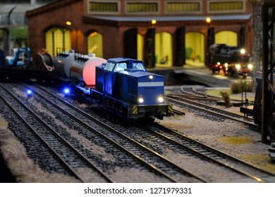 Maquette or miniature of cargo train on railway at night time