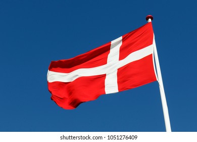 Mar 18, 2018. Jelling, Denmark. The flag of The Kingdom of Dennmark is called Dannebrog (Banner of the Danes). Danes love to fly their flag at birthdays, holidays etc.