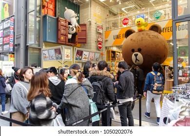 Mar 18,2018 Tourist taking photo with character at Myeongdong shopping street, Seoul, Korea