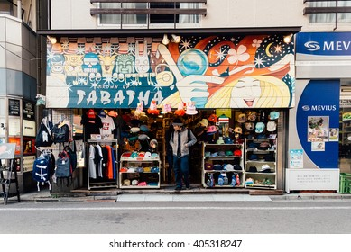 Mar 21, 2016 - Tokyo, Japan: A male walking out of an apparel shop in Shimokitazawa. The district is famous for independent fashion shops, cafes, decorations, and theaters.