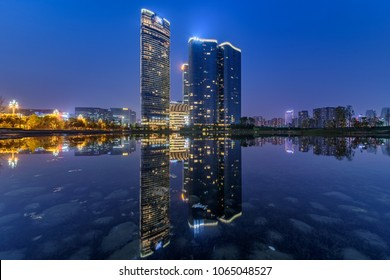 Mar 29th,2018-Chengdu,Sichuan province,China.-Skyscrapers Chengdu Yintai IN99 business centre (High-tec district,Chengdu City,China) at evening with water reflections.