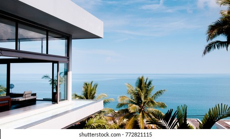 Mar 31, 2014 Phuket, Thailand : Living room in the modern villa with sea view, shot from outside of a luxury resort by the Andaman sea