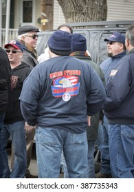 MAR 5, 2016 - WOODBRIDGE, NJ: A NJ Transit rail worker wearing a tshirt that says Union Strong - Machinist shows support of the rail labor unions at the rally a week before the strike deadline.