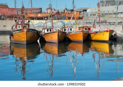 Mar del Plata, Argentina - August 22 2016: These small boats go fishing at dawn and return at sunset. They are piloted by their owners and sell fresh fish in local shops.