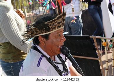 "MARACAI, SAO PAULO/BRAZIL - AUGUST 26: An unidentified indian seller at the annual religious pilgrimage of ""Menino da Tabua"" festival on August 26, 2012 in Maracai, Sao Paulo, Brazil."