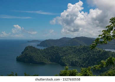 Maracas Bay Overlook in Trinidad With Blue Skies and White Clouds
